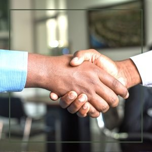 Two hands shaking completing a business transaction