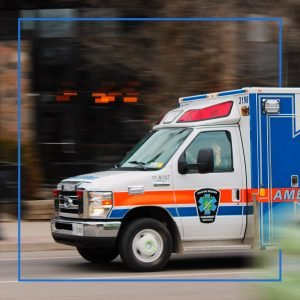 Ambulance driving through a city